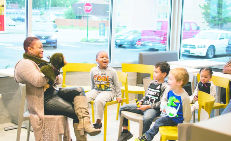 Ms. Sophia and Roscoe entertain local children and families as part to the 25th Ave McDonald's Grand Opening