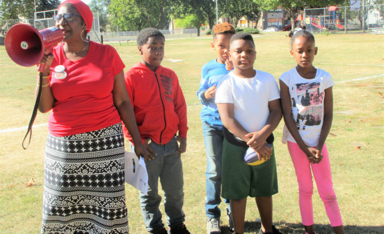 Vigil held for slain 14-year-old; 'We still care'